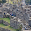 Tour Group Explores Machu Picchu