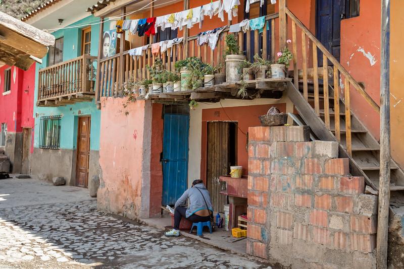 Resident Doing Laundry in Village at Ollantaytambo