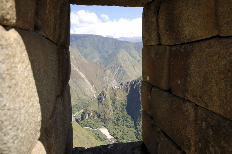 Machu Picchu, a view through a window looking out to the West and the Rio Urubamba far below.