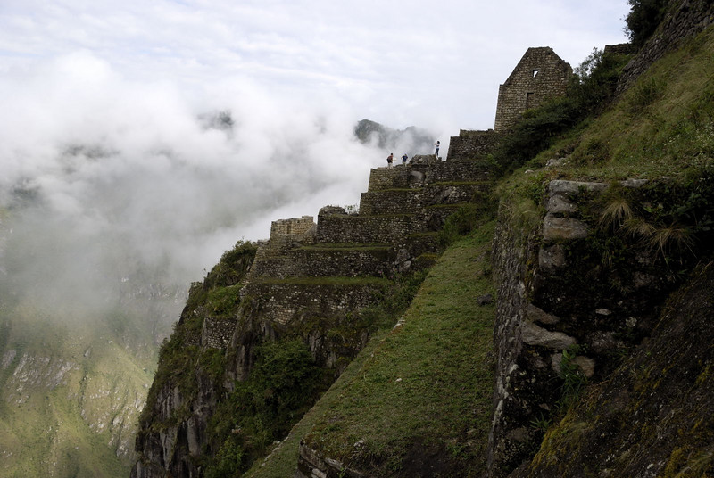 Machu Picchu, dwellings not only high on Huayna Picchu, but also balanced on the edge!