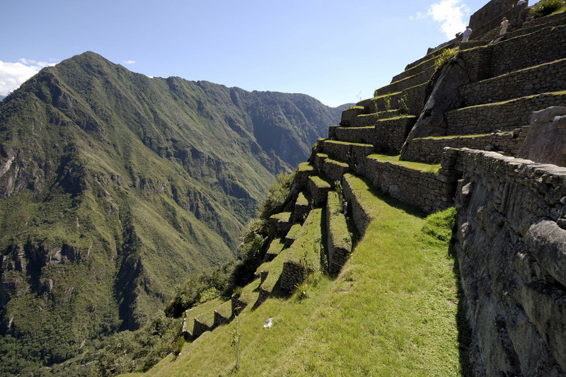 Machu Picchu, the steep steps that fall away to the West and the Rio Urubamba below.