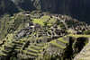 Machu Picchu, the Western Urban Sector showing the steep agricultural steps, the Sacred Plaza and the Intihuatana Pyramid.