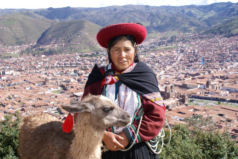 Aerieal view of Cuzc, Peru with Inca woman and Llama in foreground.