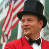 A surrey driver smiles as he heads out with Grand Hotel guests on a carriage ride around the island.
