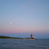 A full moon rises over Round Island lighthouse just accross from Mackinac Island