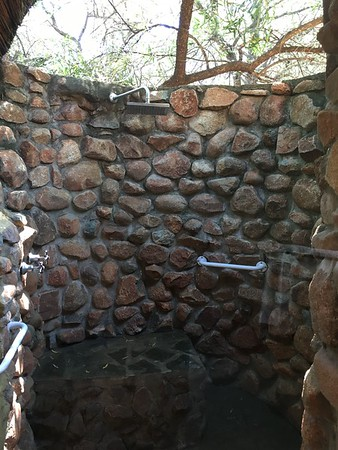A gorgeous outdoor shower! Just make sure you shut the door while you're out there to keep the monkeys out of your room!