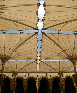 Inverted 'umbrellas' shade the courtyards within the Prophet's Mosque, Madinah.