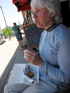 Lyn enjoys her brat at Baumgartners.
