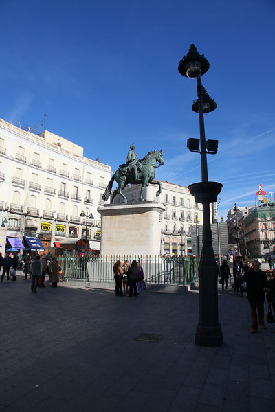 This is 'La Puerta del Sol',  Madrid's most famous and most central square, located just a short walk from the Plaza Mayor.<br /> Originally it was the site of one of the city's gates, which faced the east and was adorned with an image of the sun, hence the square's name (sungate)...