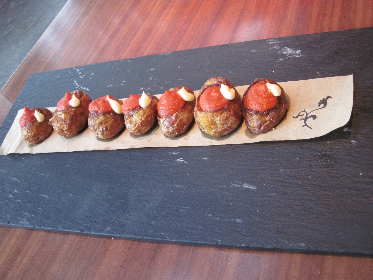 Patatas bravas. This was our first exposure to this tapa dish. This was by far the most elaborate presentation of this spicy potato dish.