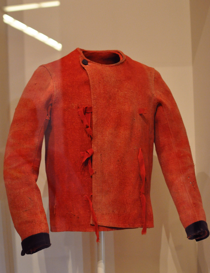 This is a 15th Century jacket, which is in display to show the effects that light and air have on historical textiles.  Notice the discolorations on the red fabric.