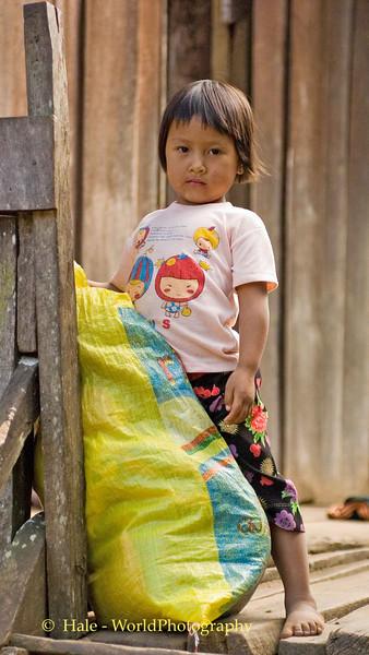 Little Lahu Girl Guarding Her Family's Rice