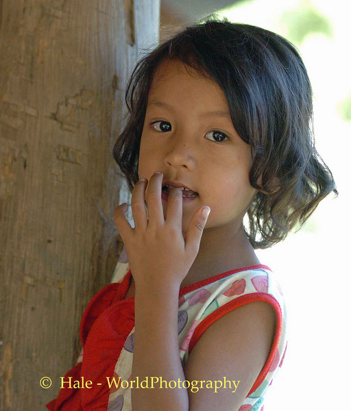 Young Girl At Vegetable Stand On the Road to Pai, Thailand