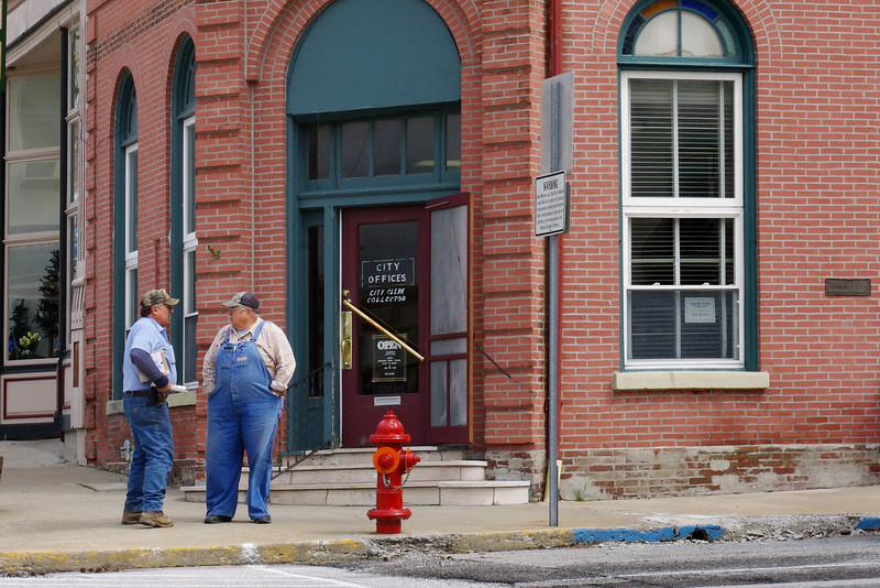 "Locals chat in front of the Glasgow (Missouri) ""Bank"" building."
