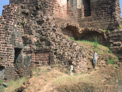 Climbing the ruins of St. Augustine, destroyed by the British during their retreat from Goa.