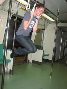 Acrobat Kyle on the rings on the Singapore MRT.