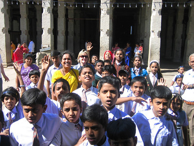 "Mom with a bunch of village school children at a temple in Mysore who are very excited to have their photo with a white lady.  The only phrase in English they know how to say is ""What is your Name?"""
