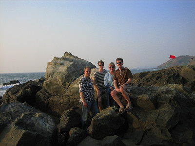 The Kolbs on some rocks at Ajuna Beach in Goa