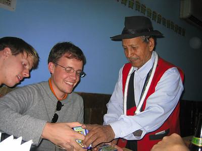 Learning magic tricks while at dinner at Priya in Agra.