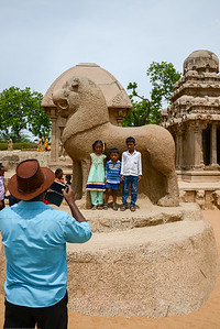 Tourists enjoy taking pictures at Panch Pandava Rathas (பன்ச் பாண்டவ ரதாஸ்). Pancha Rathas is a monument complex at Mahabalipuram, on the Coromandel Coast of the Bay of Bengal, in the Kancheepuram district of the state of Tamil Nadu, India. Pancha Rathas is an example of monolithic Indian rock-cut architecture.