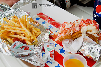 Over a whole lobster's worth of meat inside of a toasted bun.  Pure heaven....