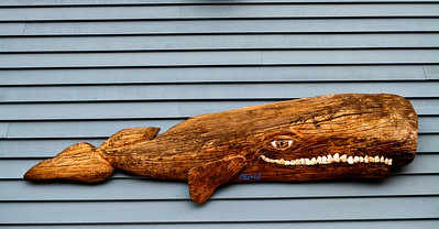 A driftwood carving of a whale in Boothbay Harbor, Maine