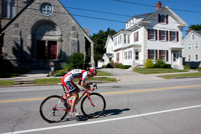 Rebeca Wellons hammers up the hill passed the local scenery to the win.