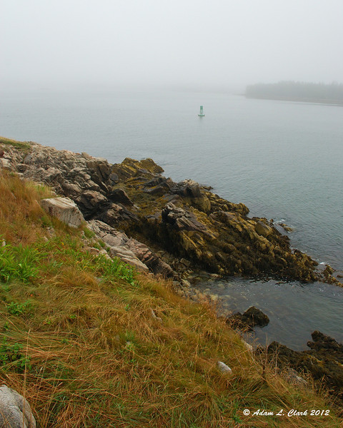 Looking down the short into Burnt Coat Harbor at the lighthouse