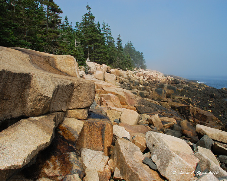 Walking up the rocky shore