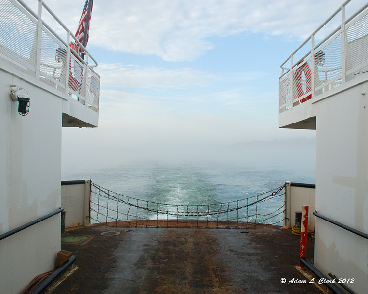 Looking off the back of the ferry headed to the island.  Still pretty foggy even away from shore