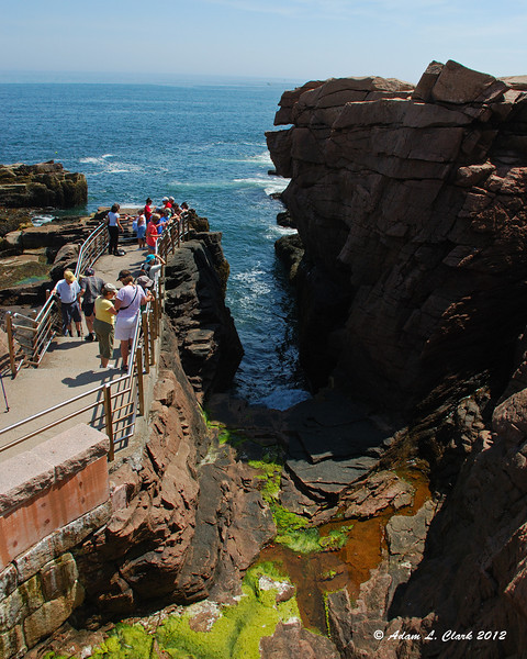This gap is Thunder Hole.  During high tide and stormy weather, the ocean waves come in here and make large splashes