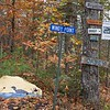 """First stop was Millinockett, recently made famous by a covid outbreak resulting from an indoor wedding. The good news is Maine is nearly covid-free at the moment.  Our cabin was """"Windy Point Cottage"""" as shown on the sign."""