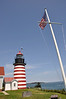 Red and white candy-striped West Quoddy Head Light. The picturesque lighthouse stands on the easternmost point of the United States mainland.