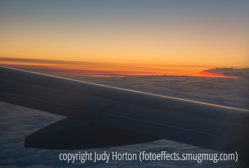 Sunrise on the Clouds Ahead...View Over the Plane's Wing