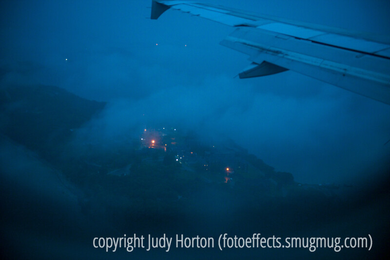 First Lights Through the Fog from the Plane