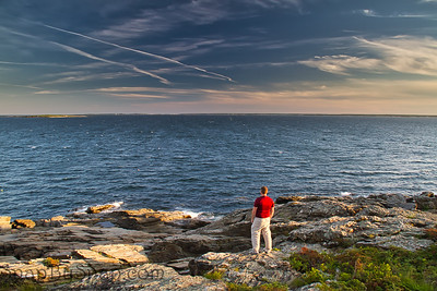 A man on the Rocky Coasting of Maine