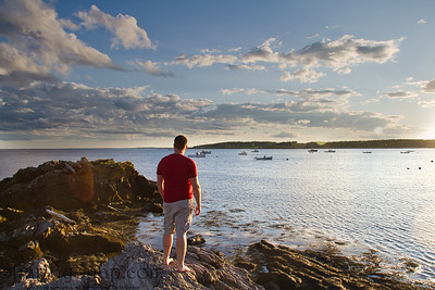 Man by the Ocean on Rocks