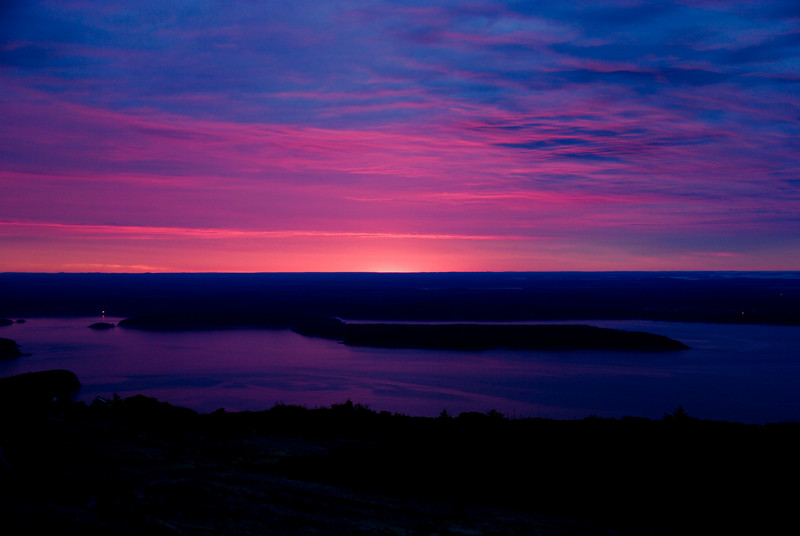 "<span id=""title"">Sunrise</span> From Cadillac Mountain (no, we didn't spend the night there). At certain times of the year, this is the first place the sun hits the US. This is a few minutes before sunrise, and the colors were amazing, but then it faded away and went behind clouds before the actual sunrise. Also, if you're with other people watching the sunrise: SHUT UP. Let people enjoy it in silence. Your jokes aren't funny, especially this early in the morning."