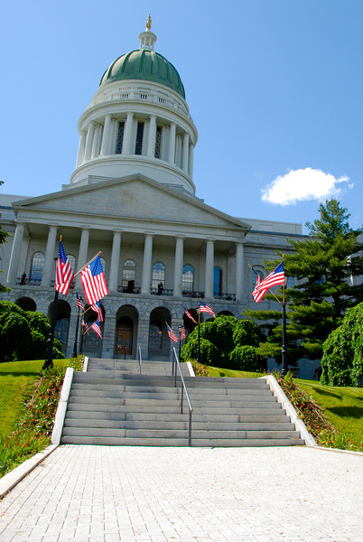 "<span id=""title"">Maine State House</span> Front view, along State Street in Augusta. I like how the flags really glow in the sunlight."