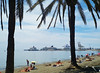 Beach near Malaga Port. Note cruise liners, which visited daily