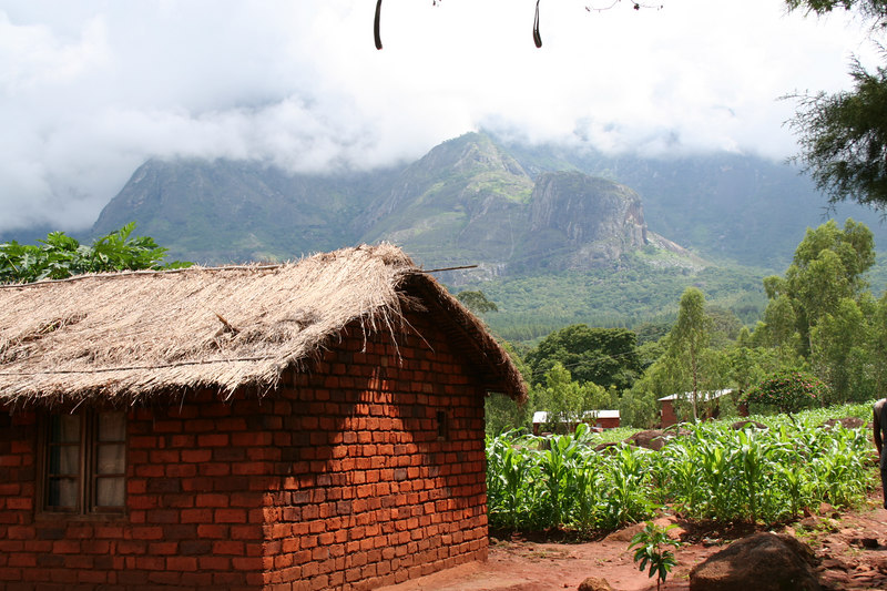 Typical home in Malawi, with Mount Mulange in the background.