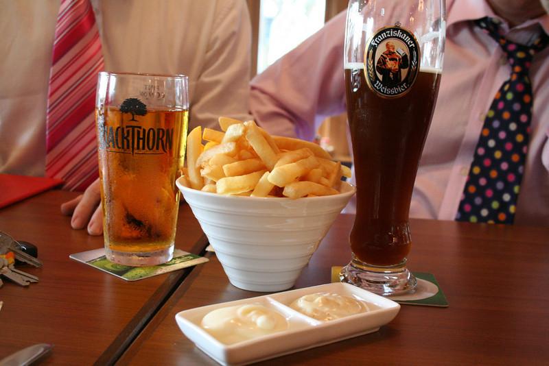 Enjoying a pint at the Belgian pub near the school!