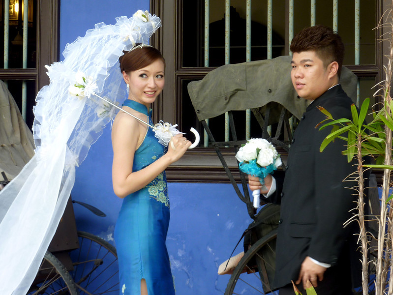 Bride and Groom posing at Blue Mansion