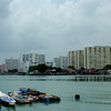 Boats by Chew Jetty, Georgetown - clan houses and high-rises in the distance
