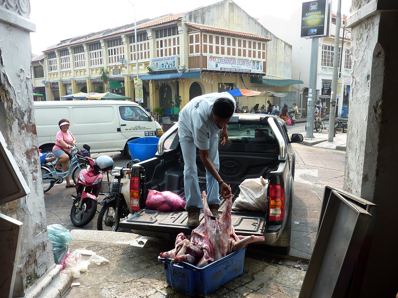 Unloading meat at an indoor market, Georgetown