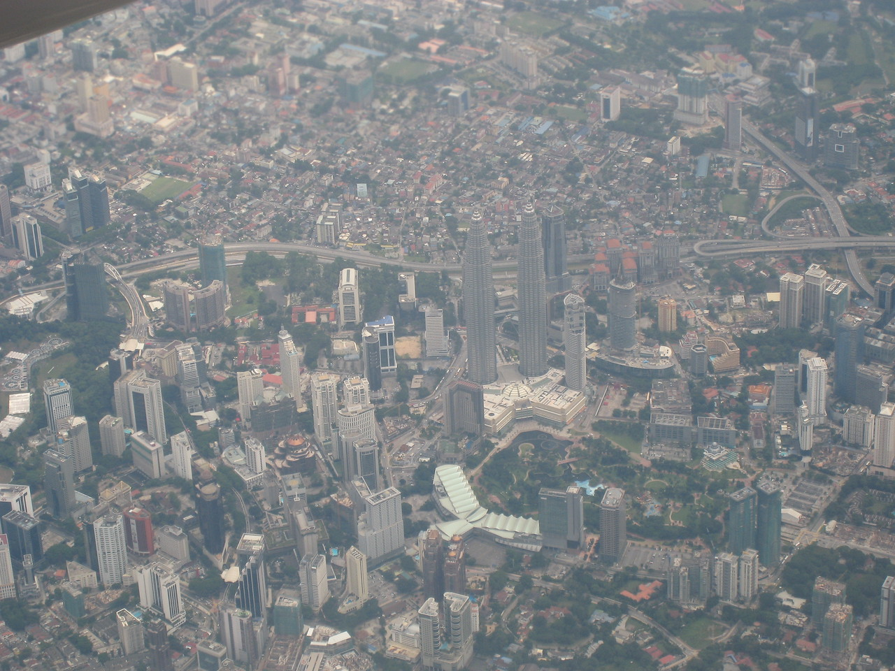 View from the plane flying into Kuala Lumpur - see the Petronas Twin Towers there?