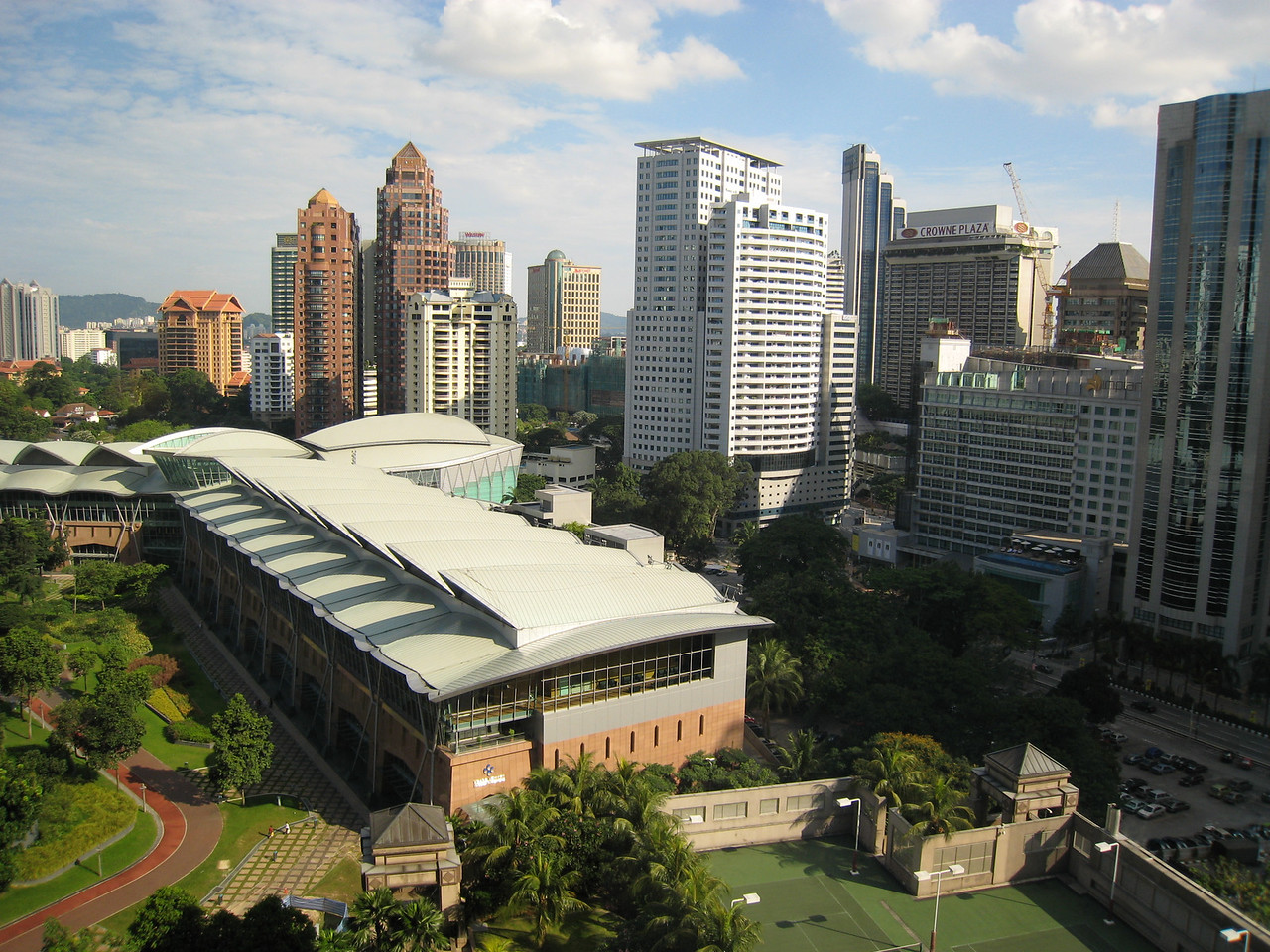 The convention centre built up right next to the park and the Petronas towers