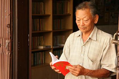 De bibliothecaris van Chinatown, Melaka, Maleisië.