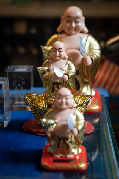 Small buddha statuettes for sale at a kiosk insite the Batu Caves Temple in Kuala Lumpur
