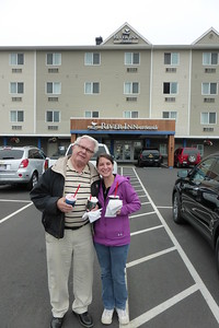 Pop and Diane standing outside our hotel with Blizzards from Dairy Queen.
